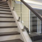 Glass railing on stairs.  North York house addition.