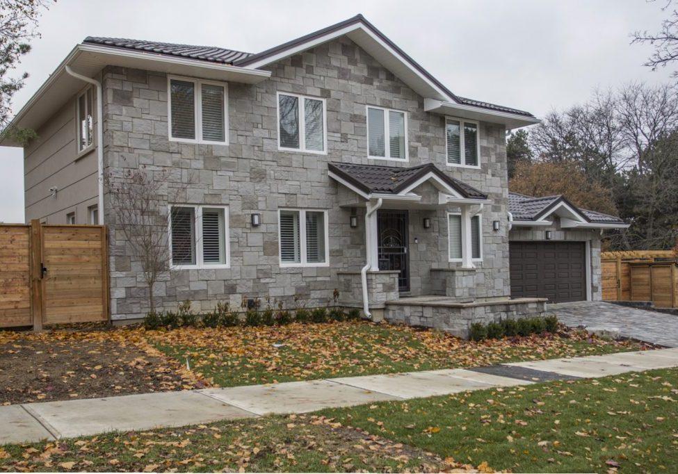 Stone & stucco facade, steel roof, energy efficient windows.  North York house addition & renovation.